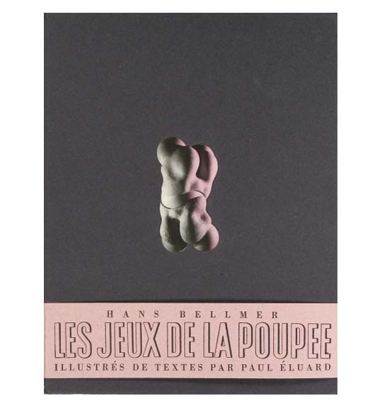 The cover of a paperbound volume or book with the title and author on a pink band at the bottom. The background is dark with a photograph of sculpture or other object, appearing as two parts connected to a sphere, perhaps like a ball and socket joint.
