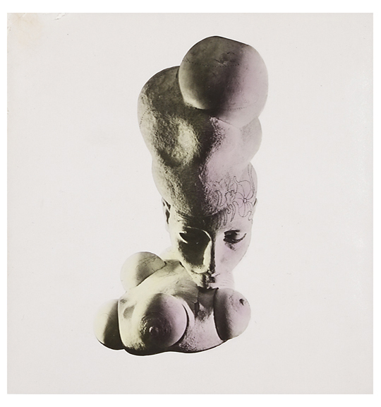 A photograph of what appears to be a bust of sculpture of a woman. The figure looks downwards, and there are several sphere or ball like objects at the base of the sculpture.