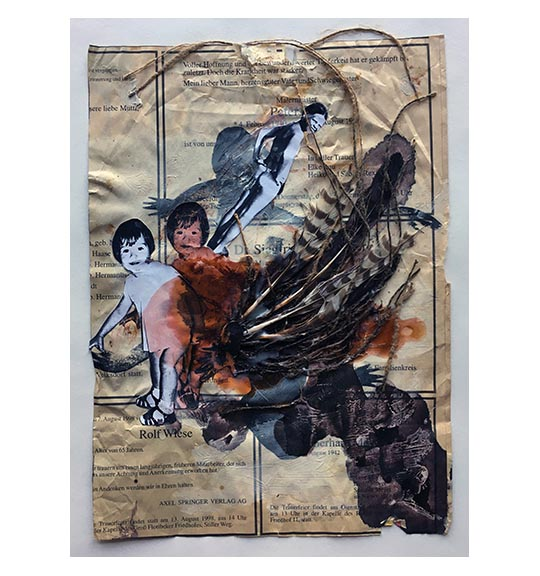 A mixed media piece featuring what appears to be a newspaper page, two images of children, an image of a woman looking over her soldier, and a bundle of feathers and threads on top of what appears to be a rusty red stain.
