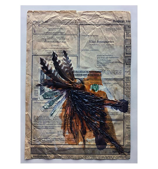 A mixed media piece featuring what appears to be a newspaper page, a partially torn American dollar bills, and several white and brown feathers. The feathers are connected to what appears to be a bundle of threads or strings, under which there is a rusty red stain or shape.