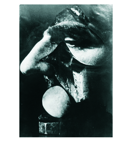 A photograph of what appears to be a man's face, focusing on the nose and eyes.