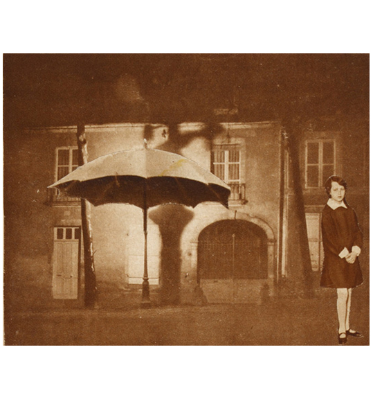 A girl stands in a black dress with a white collar with her hands clasped, on the lower right corner of the image. A building and an open umbrella appear in the background.