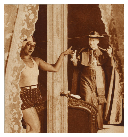 An image of a woman in a sleeveless top, shorts, and a swimming cap. She stands with her hand on her hip and the other hand outstretched and reaching toward a door or woman. A man in a dark garment and wearing a cross stands to the right.