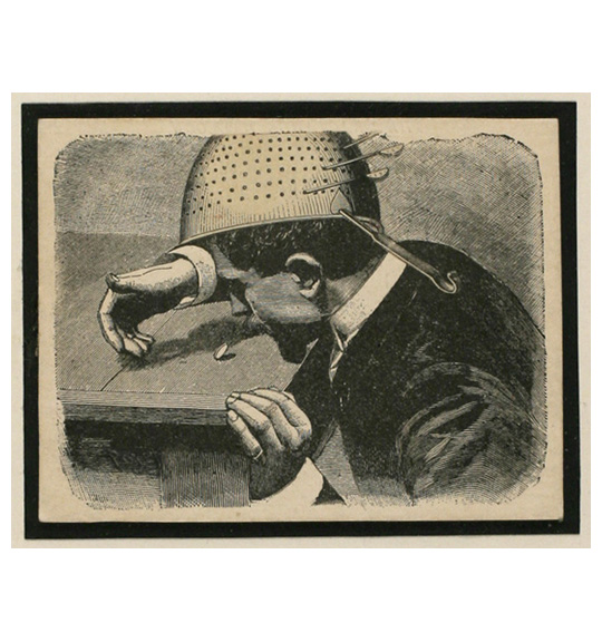 A man in profile sits or stoops at the edge of a table, wearing a colander-shaped object on his head. A coin stands on the table as if in mid-throw or mid-spin.