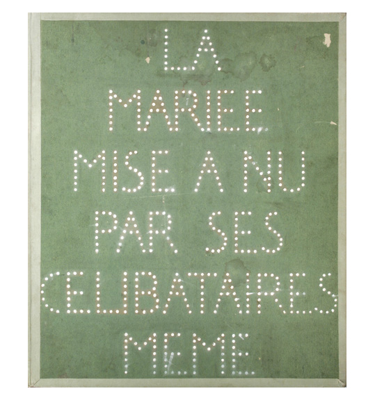 A photograph of words and letters formed by small punched out holes, or perhaps white color. The background is green with a lighter green border.