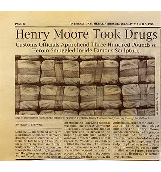 A photograph of a newspaper article from the International Herald Tribune and accompanying image. The image shows multiple wrapped parcels or packages, and the headline states: Henry Moore Took Drugs, Customs Officials Apprehend Three Hundred Pounds of Heroin Smuggled Inside Famous Sculpture.