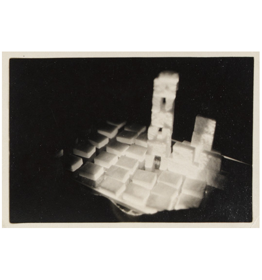 A photograph of block-like shapes, which are stacked to created a tower and another structure.